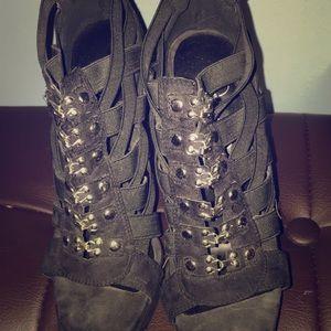 Black buckle up laser cut heels